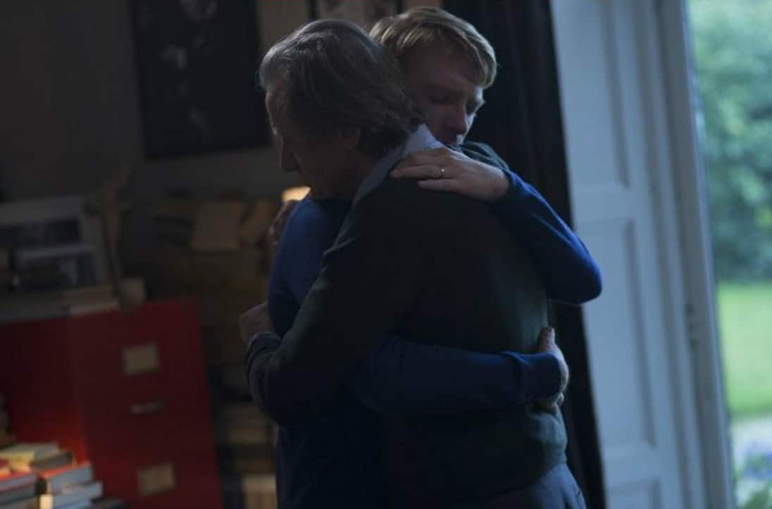 Tim (Domhnall Gleeson) and his father (Bill Nighy) embrace in About Time. Photo by Murray Close; Universal Pictures
