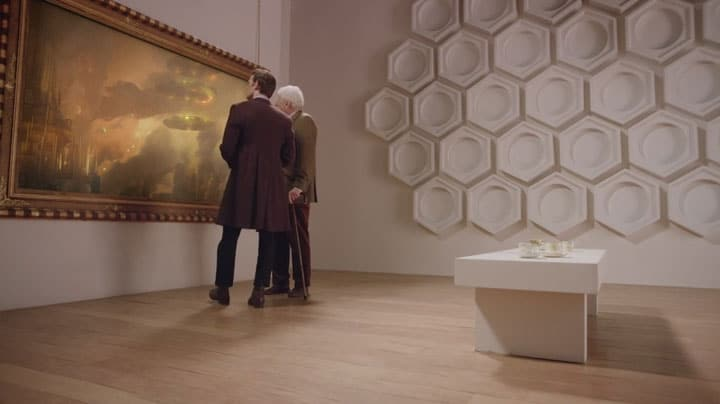 The Curator and the 11th Doctor look at the painting. Photo: BBC