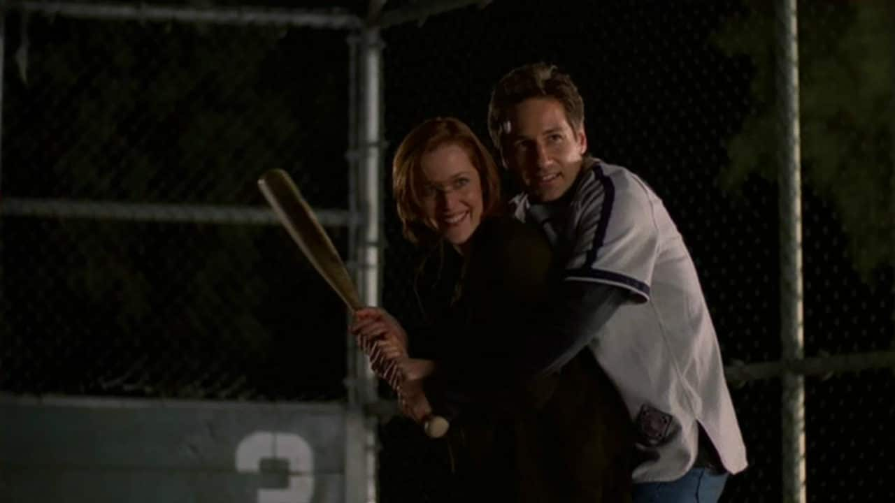 """Scully and Mulder play baseball together in the episode """"The Unnatural"""" in The X Files. Photo: Fox"""