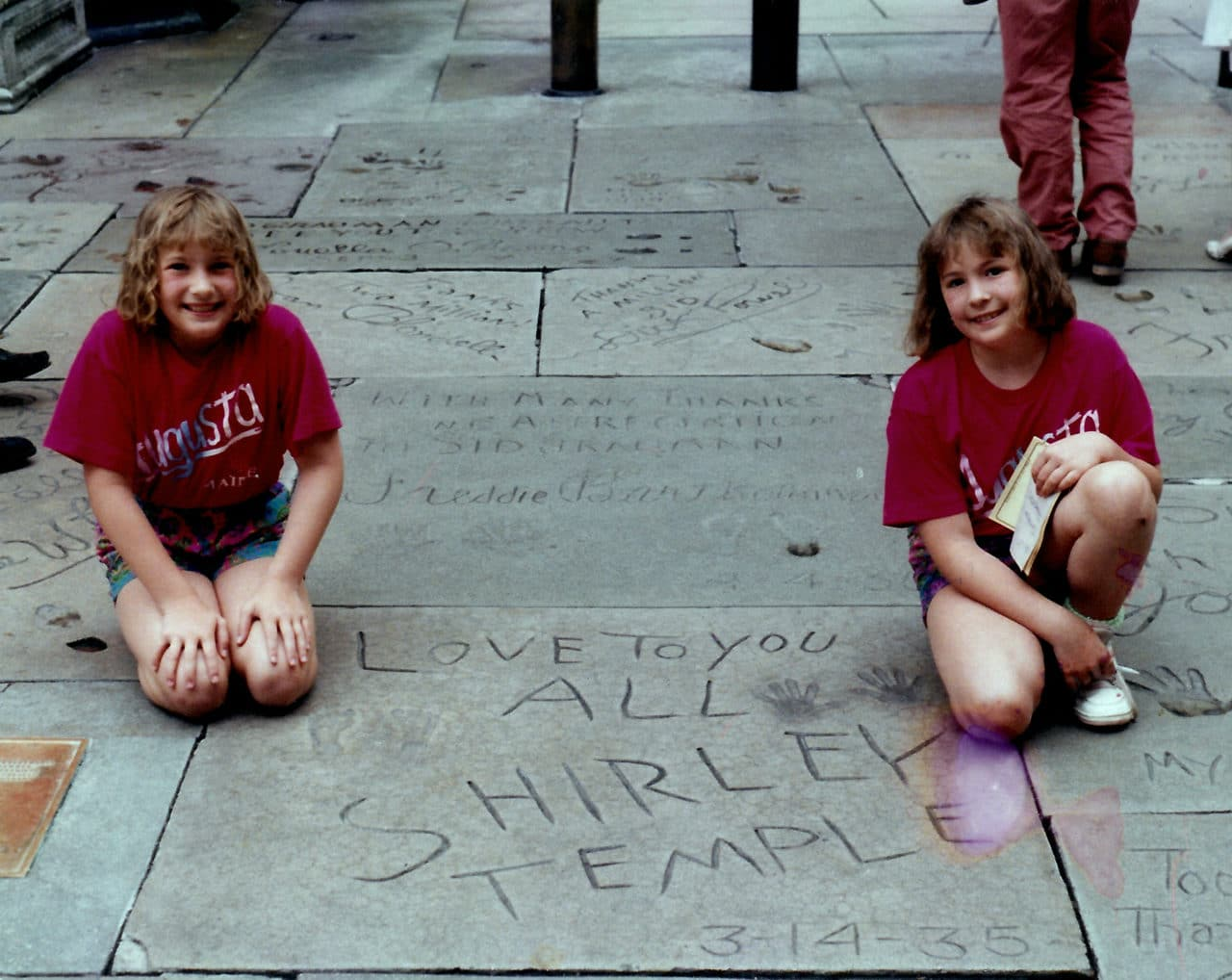 Autumn (left) and me, Amber (on right) at Grauman's Chinese Theatre posing next to Shirley Temple's handprints.