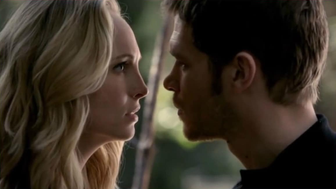 Klaus and Caroline about to kiss in The Vampire Diaries.