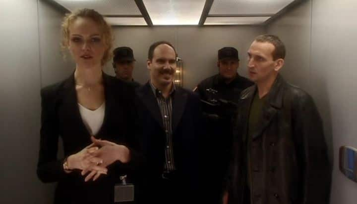 Goddard, The Doctor and Van Statten in elevator