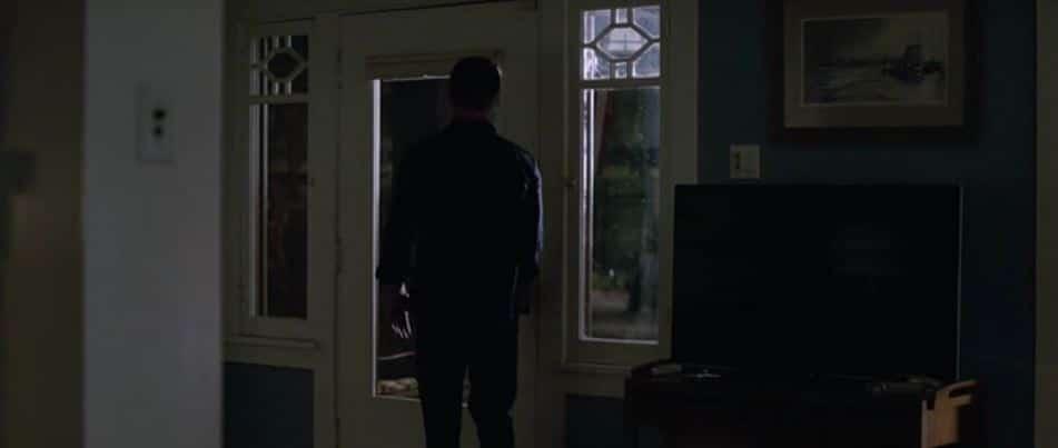 Logan reaches for door