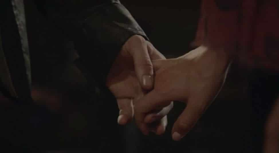 Klaus and Cami hold hands 2