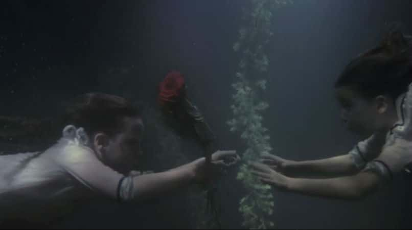 "The young twins facing each other in water ""psychically"" soon after their initial separation. Photo: Miramax."