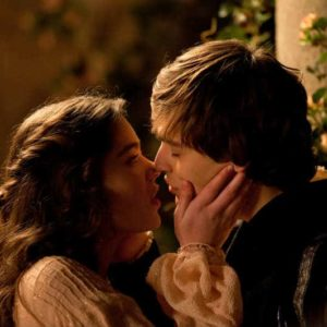 Juliet (Hailee Steinfeld) and Romeo (Douglas Booth) pledge their love to each other.