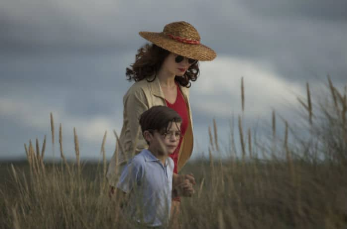 Vera Claythorne walking with her young charge, Cyril in And Then There Were None