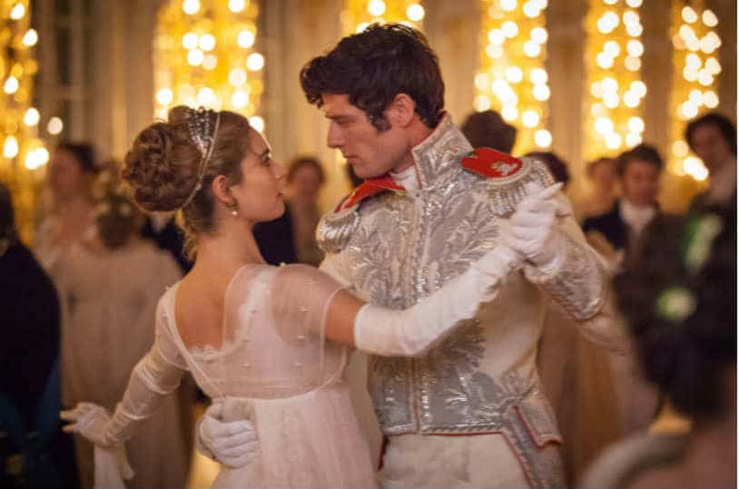 "Natasha (Lily James) and Andrei (James Norton) share a dance in Andrew Davies ""War and Peace."" 