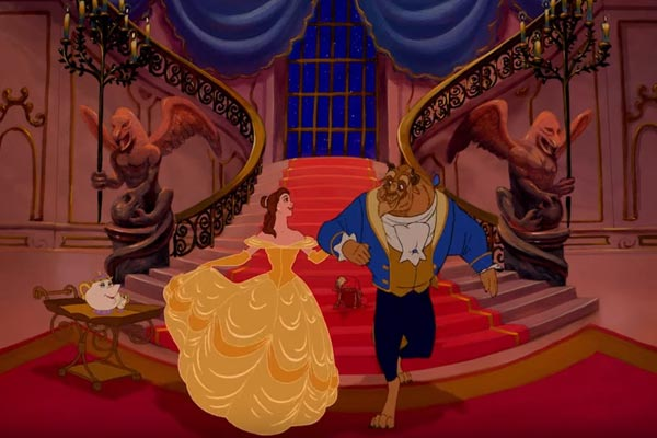 Beauty and the Beast enter the ballroom. Photo: Disney; beauty and the beast adaptations