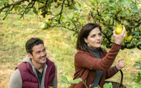 Harvest Love | Luna (Jen Liley) reaches to pick a pear, unaware Will (Ryan Paevey) watches her!