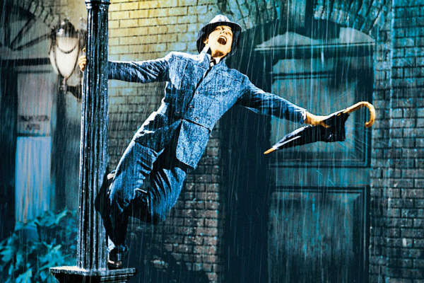 April Showers: 30 of the Most Romantic Moments in the Rain - Singing in the Rain