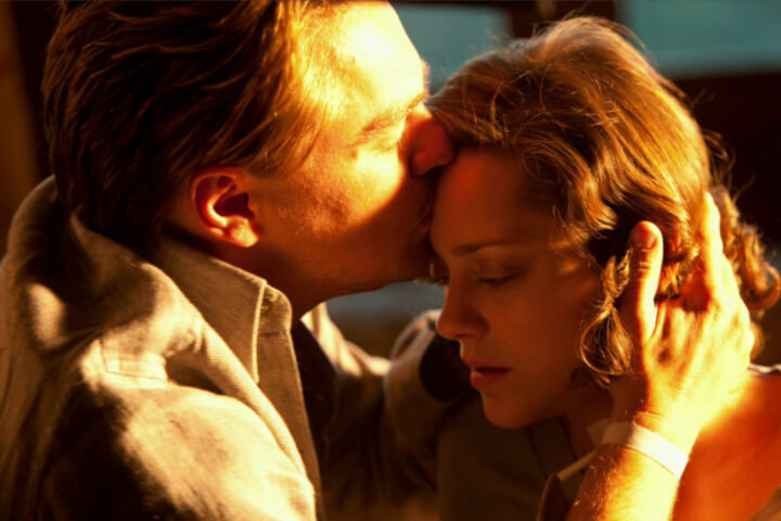 Leonardo Dicaprio kisses Marion Cotillard's head in Inception. Top 5 of the Most Romantic Leonardo Dicaprio Movies to Watch