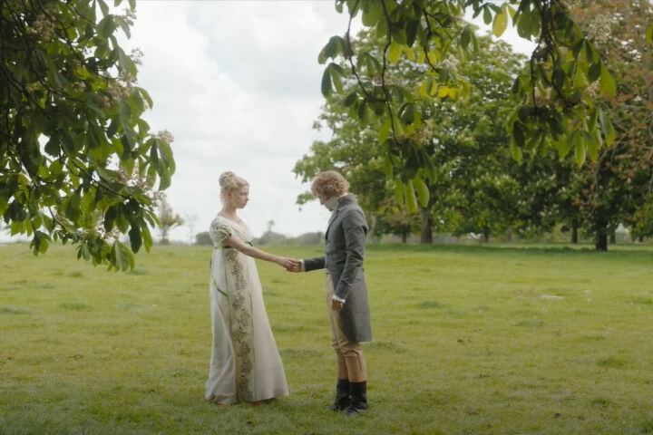 Emma takes Knightley's hand.