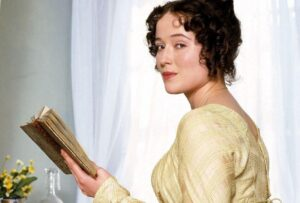 A Literary Halloween: 20 Female Book Characters to Dress Up As! Featured Image of Elizabeth Bennet reading a book.