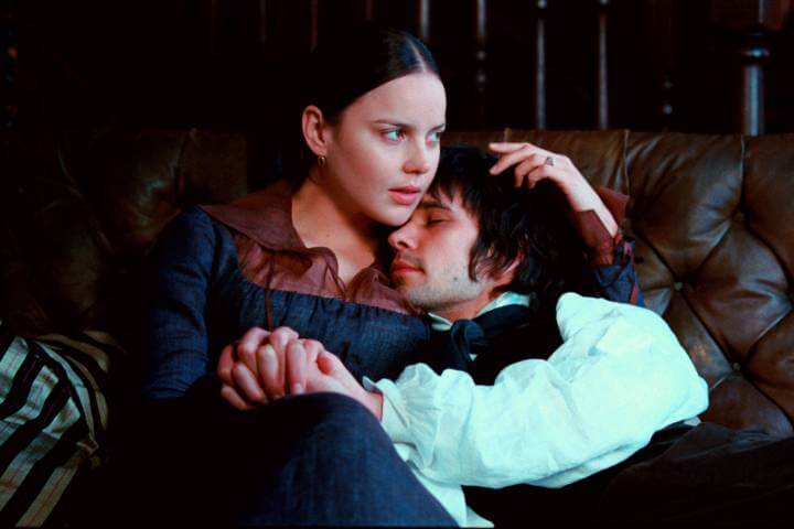 Bright Star promotional photo. The two actors are holding hands while sitting on a couch.