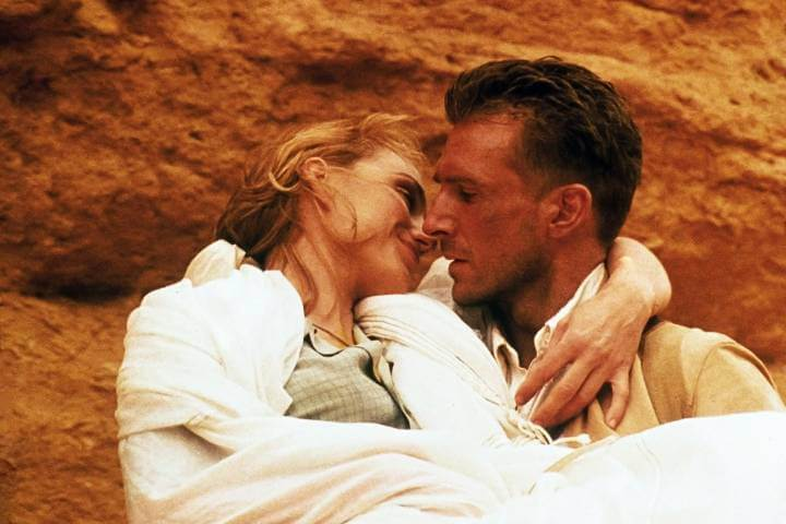 The English Patient publicity still with Kristin Scott Thomas and Ralph Fiennes. He carries her in the desert.