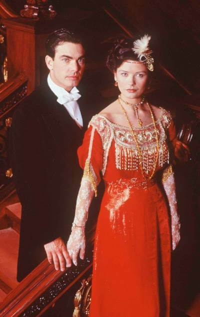 Titanic 1996 promo image with Peter Gallagher and Catherine Zeta-Jones in period costume.