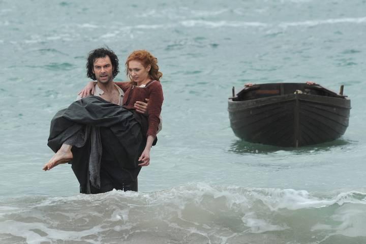 Ross carrying Demelza; shot taken at Kynance Cove