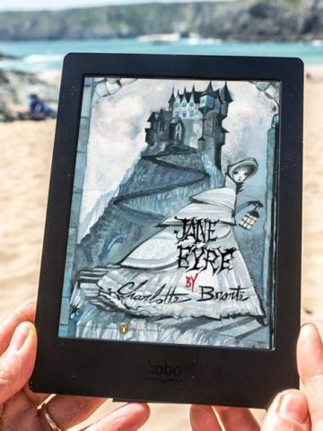Jane Eyre Discussion Questions Featured image with Gothic Jane Eyre book cover and a beach background